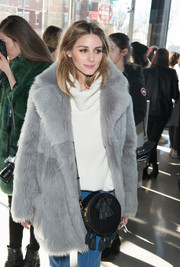 Olivia Palermo attended the Tibi fashion show carrying a tasseled black shoulder bag by Rebecca Minkoff.