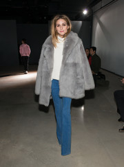 Olivia Palermo glammed up her turtleneck and jeans with a gray fur coat by Tibi for the label's fashion show.