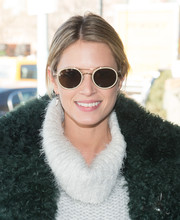 Helena Bordon arrived for the Tibi fashion show wearing a cool pair of round sunglasses.