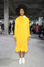 Jessica Williams brightened up the Tibi show with this long-sleeve yellow midi dress from the brand.