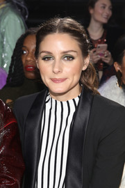 Olivia Palermo styled her hair into a center-parted, half-up 'do for the Tibi fashion show.