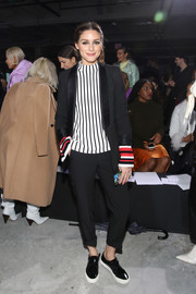 Olivia Palermo punctuated her black suit with a striped blouse.