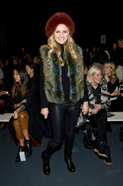 Candice Lake brought her winter style to the Tibi fashion show with this fur vest and hat combo.