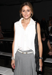 Olivia Palermo added glamorous shine to her casual outfit with a silver cuff bracelet when she attended the Tibi fashion show.