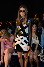Olivia Palermo exuded a punk vibe in a graphic-print top with mesh sleeves and a matching mini skirt during the Tibi fashion show.