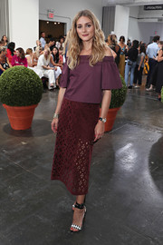 Olivia Palermo was trendy and feminine in a plum-colored off-the-shoulder top by Tibi while attending the label's fashion show.