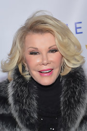 Joan Rivers arrived at an event in New York in a stylish short wavy haircut.