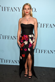 Reese Witherspoon exuded ultra-feminine elegance at the Tiffany & Co. Blue Book Gala in a J. Mendel strapless gown with a floral-embellished skirt.