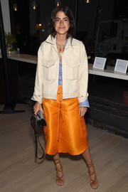 Leandra Medine styled her outfit with sexy tan gladiator heels.