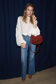 Dree Hemingway completed her look with a red leather shoulder bag.