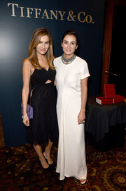 Camilla Belle styled her LBD with a Bulgari Serpenti bag, in lilac.