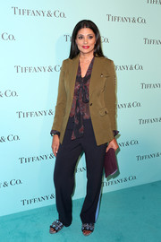 Rachel Roy paired navy slacks with a printed pussybow blouse for the unveiling of Tiffany & Co.'s renovated Beverly Hills store.