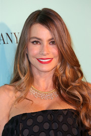 Sofia Vergara decorated her bare neckline with a gorgeous gold and diamond fringe necklace by Tiffany & Co.