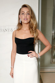 Amber Heard was dripping with Tiffany & Co. diamonds when she attended the jeweler's cocktail party in Toronto.