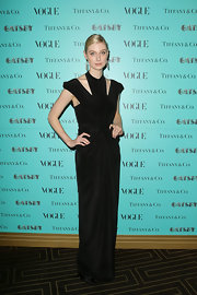 Elizabeth Debicki rocked a totally gorgeous black gown that featured a black neck piece and two shoulder cutouts.