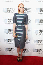 Jena Malone coordinated her frock with a teal and gold box clutch by Lee Savage.