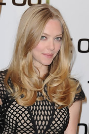 Amanda Seyfried tried something a little different at a photocall for 'Time Out.' She wore her hair with a center part and added lots of volume.
