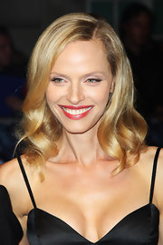 Rachel Roberts wore her blond locks with a deep side part and subtle curls at the UK premiere of 'In Time.'