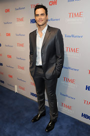 Cheyenne Jackson's shimmery gray suit was a super fashionable choice for the 'Beyond 9/11' photo exhibit.