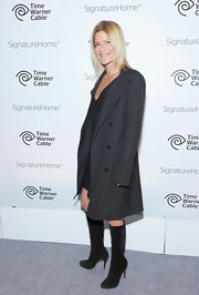 Lizzie Grubman looked chic in a pair of knee high suede Christian Louboutin boots.