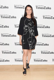 Lucy Liu kept it laid-back in a face-motif T-shirt dress by Stella McCartney when she attended TimesTalks.