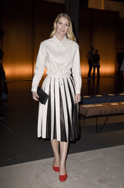 A simple black leather clutch finished off Kitty Spencer's ensemble.