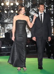 Milla Jovovich looked ultra-sexy in a black strapless bandage gown for the Tokyo International Film Festival.