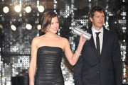 Milla Jovovich and Paul W.S. Anderson walk on the green carpet during the Tokyo International Film Festival Opening Ceremony at Roppongi Hills on October 22, 2011 in Tokyo, Japan.