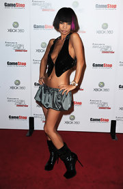 Bai Ling sported a straight blunt cut bob with bangs and a vibrant pink streak framing her face.
