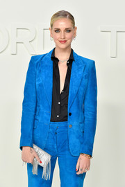 Chiara Ferragni's beaded, fringed silver clutch and electric-blue pantsuit were a perfect pairing!