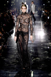 Gigi Hadid looked super sultry in a sheer black lace gown while walking the Tom Ford Fall 2020 runway.