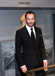 Tom Ford looks completely cool in his classic tux and buzzed hair.