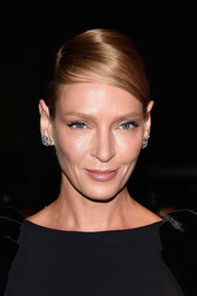 Uma Thurman opted for a classic French twist when she attended the Tom Ford fashion show.
