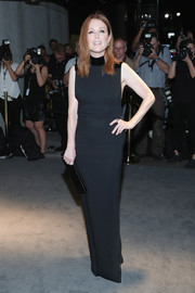 Julianne Moore was all about minimalist elegance in a black Tom Ford column dress with velvet detailing when she attended the label's fashion show.