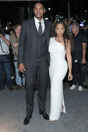 La La Anthony sizzled in a curve-flaunting white one-shoulder gown by Tom Ford during the label's fashion show.