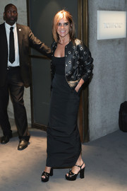 Carine Roitfeld was ageless and hip in a grommeted leather jacket while attending the Tom Ford fashion show.