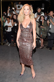 Rita Ora sheathed her curvy figure in a low-cut pink sequin dress by Tom Ford for the label's fashion show.