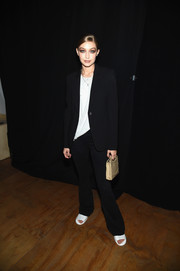 Gigi Hadid kept it simple in a black pantsuit at the Tom Ford fashion show.
