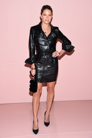 Helena Bordon was rocker-chic in a black leather biker dress at the Tom Ford Spring 2018 show.