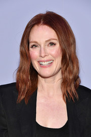 Julianne Moore sported edgy shoulder-length waves at the Tom Ford fashion show.