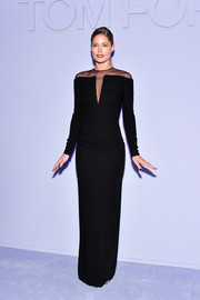 Doutzen Kroes was the picture of elegance in a sheer-panel black column dress by Tom Ford during the label's Fall 2018 show.