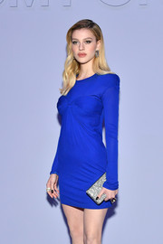 Nicola Peltz's silver glitter clutch and electric-blue frock at the Tom Ford show were a gorgeous pairing!