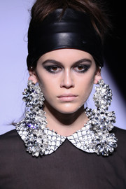 Kaia Gerber looked super edgy with her wide leather headband and smoky eyes at the Tom Ford runway show.