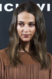 Alicia Vikander framed her face with a subtly wavy 'do for the 'Tomb Raider' photocall in Madrid.