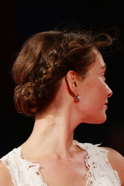 Cristiana Capotondi opted for a classic braided bun when she attended the Venice Film Festival premiere of 'Tommaso.'