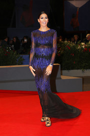 Elisabetta Gregoraci joined the sheer trend with this black and purple number at the Venice Film Festival premiere of 'Tommaso.'