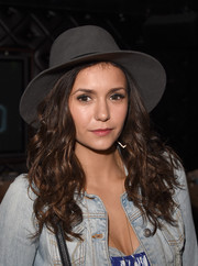 Nina Dobrev topped off her 'do with a gray fedora.