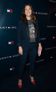 Drew Barrymore showed her classic style with a navy blue pantsuit at the Tommy Hilfiger LA flagship opening.