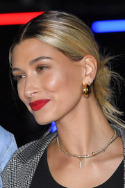 Hailey Baldwin brightened up her pretty face with a swipe of bold red lipstick.