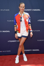 Hannah Davis totally got into the athletic spirit in this colorful varsity jacket during the Tommy Hilfiger and Rafael Nadal global brand ambassadorship launch.